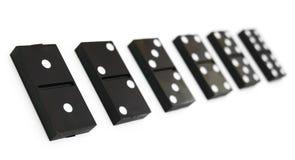 在空白背景的Domino。 库存照片