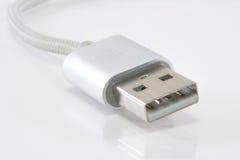 在空白背景的USB电缆 库存图片