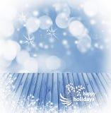 在空的木,蓝色桌背景写的愉快的假日,准备好您的产品显示蒙太奇 担任主角雪花光aro 库存照片