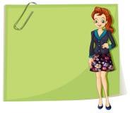 在空的模板前面的一个年轻企业女孩 库存照片