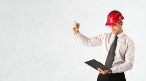 在空的空间的年轻建筑师图画 免版税库存图片