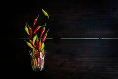 在空间木桌上的新鲜的辣椒给的t做广告 免版税图库摄影