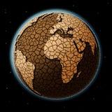 在空间的干燥地球 免版税库存照片
