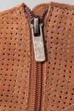 在穿孔的绒面革的起动拉链 免版税库存图片
