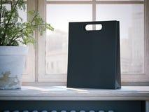 在窗口基石的黑购物袋 3d翻译 库存照片