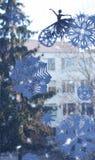 在窗口的纸装饰 库存图片