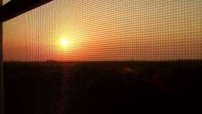 在窗口的蚊帐在日落的背景 股票视频