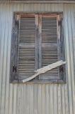 在窗口的闭合的快门 免版税库存照片
