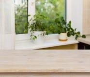 在窗口背景的木桌 免版税图库摄影