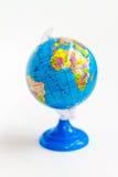 在立场的五颜六色的地球与非洲大陆 免版税库存图片