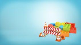 在站立在一五颜六色的lego前面的几个交通锥体旁边的一个镶边路障标志阻拦堆 图库摄影