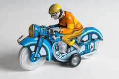 在竞选中获胜的成功的玩具摩托车 库存图片