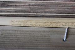 在竹叶子的古老佛教佛经 库存图片