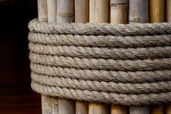 在竹子的绳索领带 库存照片