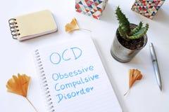 在笔记本写的OCD强迫性的混乱 免版税库存照片