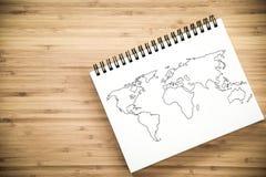 在笔记本的世界地图概述 免版税图库摄影