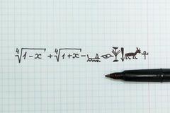 在笔记本的复杂数学例子作为埃及象形文字 免版税库存照片