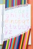 在笔记本的字母表 库存图片