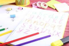 在笔记本的手写的字母表 库存照片
