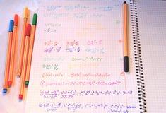在笔记本的数学家庭作业 库存图片