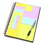 在笔记本的笔记薄与笔 免版税库存图片