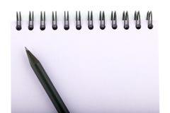 在笔记本的铅笔 免版税图库摄影