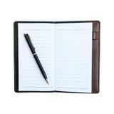 在笔记本的黑企业笔有在whi隔绝的皮革盒的 库存照片