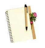 在笔记薄的翠菊芽 图库摄影