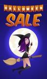 在笤帚的万圣夜性感的巫婆飞行从精品店购物销售 库存照片