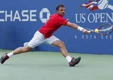 在第三次回合比赛期间的职业网球球员斯坦尼斯拉斯・瓦夫林卡在美国公开赛2013年 免版税库存照片