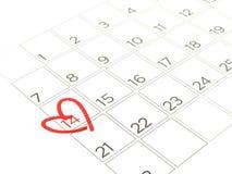 在第14附近的特写镜头红色心脏标记在白色背景隔绝的日历2月页 免版税图库摄影