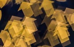 在箭头形状的抽象迷离bokeh背景 免版税库存图片