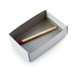 在箱子的一次木比赛被隔绝在白色背景 免版税库存图片