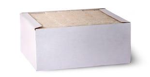 在箱子的前面白糖立方体 图库摄影