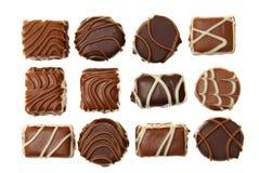 在箱子的各种各样的巧克力糖 免版税图库摄影