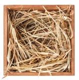 在箱子的干草 免版税库存图片
