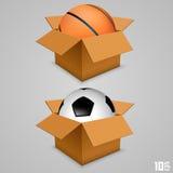 在箱子的球 免版税库存照片