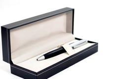 在箱子的笔 免版税库存照片