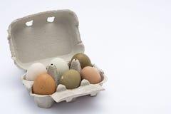 在箱子的色的鸡蛋 免版税库存照片