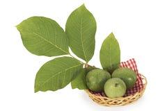 在篮子的三枚绿色坚果 免版税库存图片