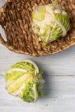 在篮子的两个花椰菜在白色背景 库存图片