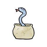 在篮子的动画片蛇 免版税库存图片
