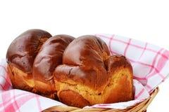 在篮子的甜结辨的面包 库存照片