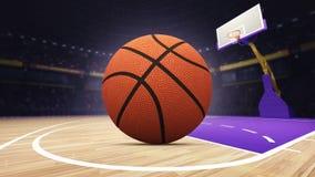在篮球场的篮子球在竞技场 库存照片