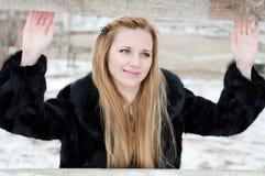 在篱芭后的女孩 图库摄影