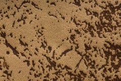 在米黄棕色颜色的呈杂色的纺织品背景 免版税库存图片