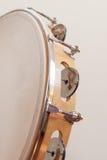 在米黄背景的垂直的小手鼓 图库摄影