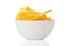 在精巧彩色陶器的开胃,金黄芯片滚保龄球 免版税库存图片