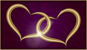 在紫色天鹅绒的两金黄心脏 库存图片
