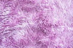 在紫色织品地毯的特写镜头表面抽象织品样式在房子纹理背景地板  免版税库存图片